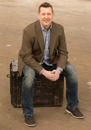 Stephan Schnaiter loan officer sitting on trunk